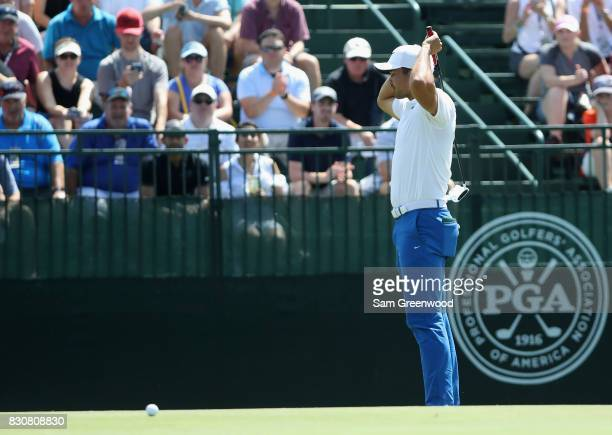Jason Day of Australia reacts to a missed shot for birdie on the fourth hole during the third round of the 2017 PGA Championship at Quail Hollow Club...