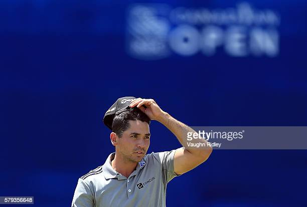 Jason Day of Australia reacts to his eagle putt on the 18th hole during the third round of the RBC Canadian Open at Glen Abbey Golf Club on July 23...