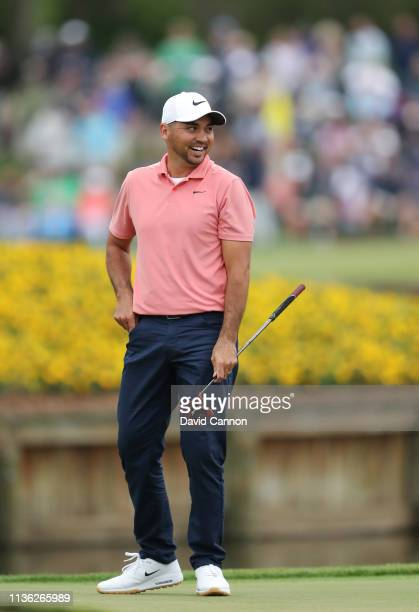 Jason Day of Australia reacts to his putt on the par 3, 17th hole during the third round of the 2019 Players Championship held on the Stadium Course...