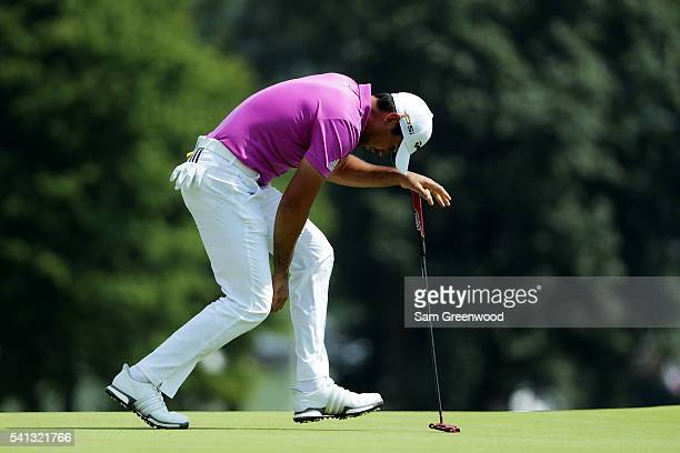Jason Day of Australia reacts to his putt on the third hole during the final round of the US Open at Oakmont Country Club on June 19 2016 in Oakmont...