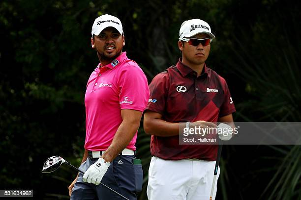 Jason Day of Australia reacts to his shot from the fifth tee as Hideki Matsuyama of Japan looks on during the final round of THE PLAYERS Championship...
