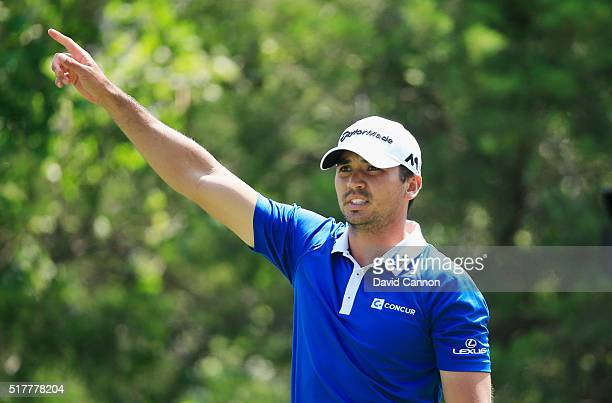 Jason Day of Australia reacts to his tee shot on the 18th hole during his semifinal match with Rory McIlroy at the World Golf ChampionshipsDell Match...