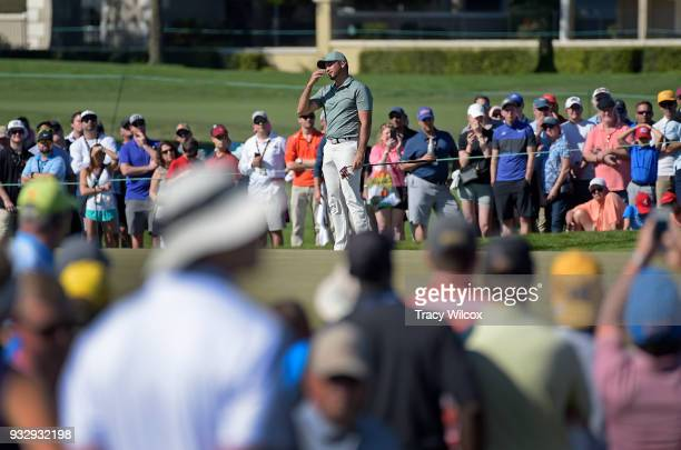 Jason Day of Australia reacts to missing his birdie putt at hole No 13 during the second round of the Arnold Palmer Invitational presented by...