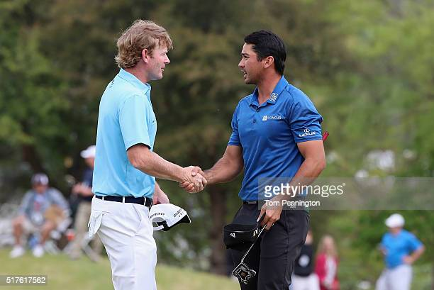Jason Day of Australia shakes hands with Brandt Snedeker of the United States after Day won their match 32 on the 16th green during the round of 16...