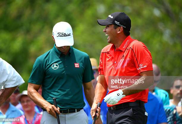 Jason Day of Australia shares a laugh with his caddie and fellow golfers at the first hole during the first round of the Memorial Tournament...