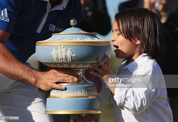 Jason Day of Australia shares the Walter Hagen Cup with his son Dash after defeating Louis Oosthuizen of South Africa 54 in the championship match of...