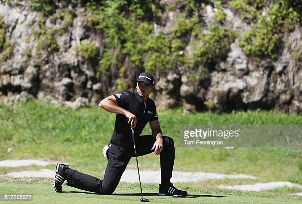 Jason Day of Australia stretches on the third green during the second round of the World Golf ChampionshipsDell Match Play at the Austin Country Club...