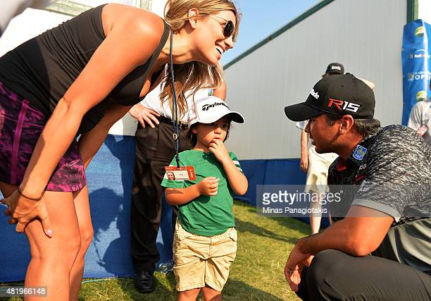 Jason Day of Australia talks to his son Dash and wife Ellie after finishing round three of the RBC Canadian Open at Glen Abbey Golf Club on July 25...