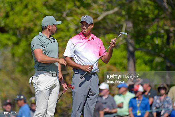Jason Day of Australia talks with Tiger Woods at hole No 2 during the second round of the Arnold Palmer Invitational presented by MasterCard at Bay...