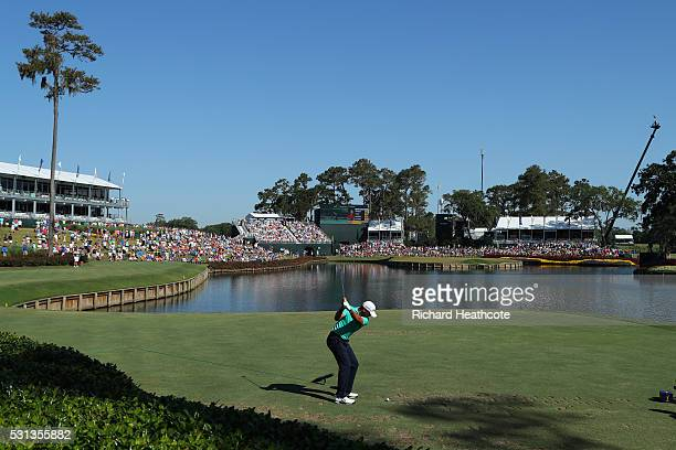 Jason Day of Australia tee's off at the 17th during the resumption of the weather delayed second round of THE PLAYERS Championship at the Stadium...