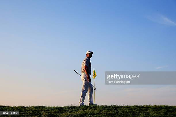 Jason Day of Australia waits behind the 16th green during the third round of the 2015 PGA Championship at Whistling Straits at on August 15 2015 in...