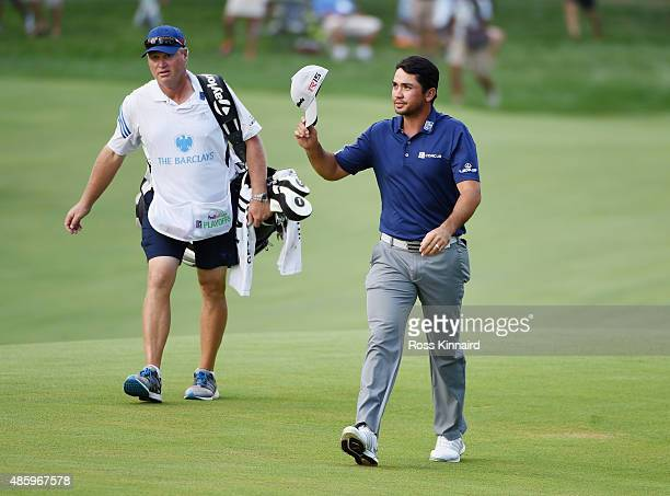 Jason Day of Australia walks to the 18th green with his caddie Colin Swatton during the final round at The Barclays at Plainfield Country Club on...