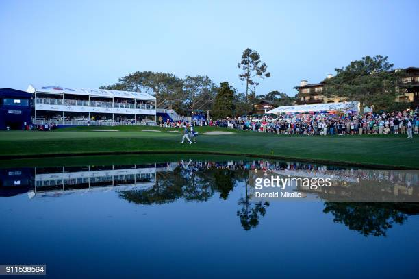 Jason Day of Australia walks up the 18th green during the fifth playoff during the final round of the Farmers Insurance Open at Torrey Pines South on...