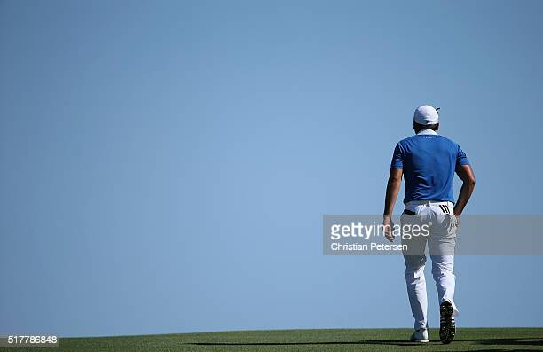 Jason Day of Australia walks up the tenth fairway during his match against Louis Oosthuizen of South Africa in the championship match of the World...