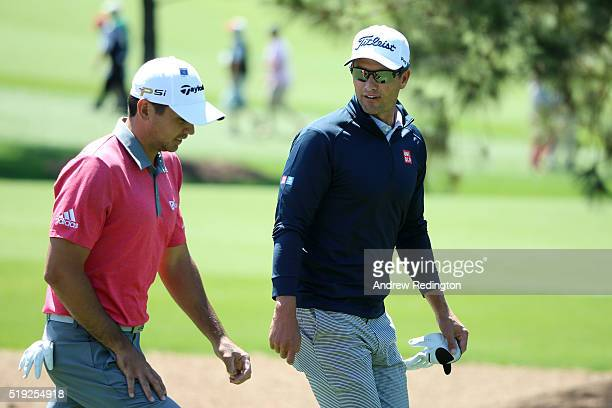 Jason Day of Australia walks with Adam Scott of Australia during a practice round prior to the start of the 2016 Masters Tournament at Augusta...