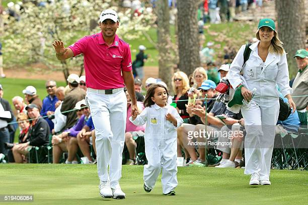 Jason Day of Australia walks with his wife Ellie Day and their son Dash during the Par 3 Contest prior to the start of the 2016 Masters Tournament at...