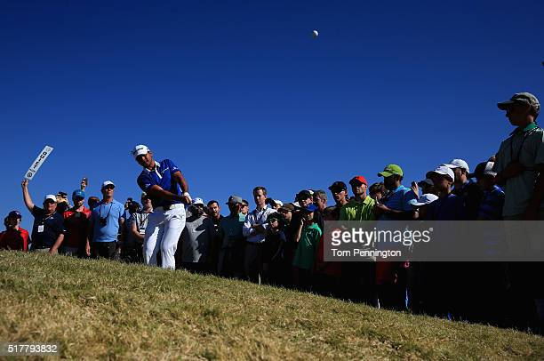 Jason Day of Australia watches a pitch shot on the 12th hole during his match against Louis Oosthuizen of South Africa in the championship match of...