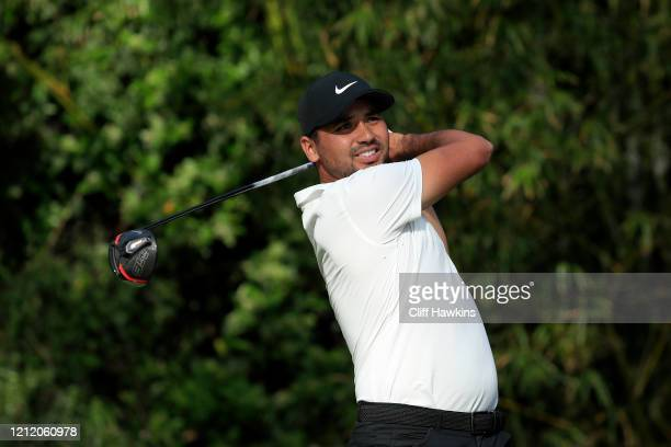 Jason Day of Australia watches his drive on the 11th hole during the first round of The PLAYERS Championship on The Stadium Course at TPC Sawgrass on...