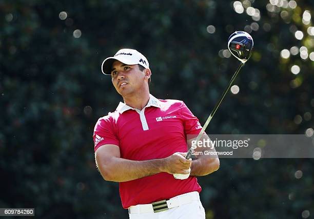 Jason Day of Australia watches his tee shot on the 14th hole during the first round of the TOUR Championship By CocaCola at East Lake Golf Club on...