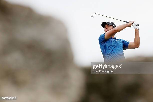Jason Day of Australia watches his tee shot on the seventh hole during the round of 16 in the World Golf ChampionshipsDell Match Play at the Austin...