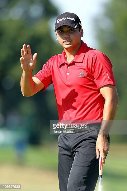 Jason Day of Australia waves to the fans after he made a birdie on the tenth hole during the third round of The Barclays at the Ridgewood Country...