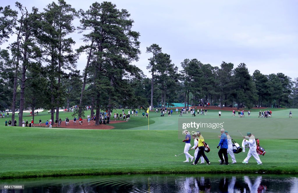 Jason Day of Australia,Yuta Ikeda of Japan and Sandy Lyle of Scotland on the 16th hole during a practice round prior to the start of the 2017 Masters Tournament at Augusta National Golf Club on April 3, 2017 in Augusta, Georgia.