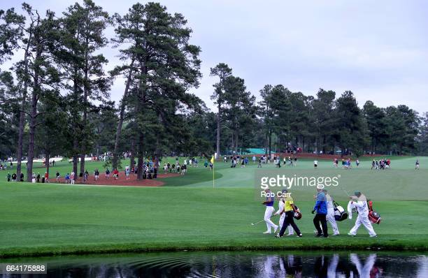 Jason Day of AustraliaYuta Ikeda of Japan and Sandy Lyle of Scotland on the 16th hole during a practice round prior to the start of the 2017 Masters...