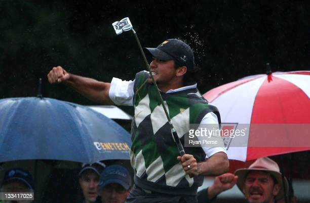 Jason Day of the International Team celebrates a putt on the 17th hole during the Day Three Afternoon Four-Ball Matches of the 2011 Presidents Cup at...