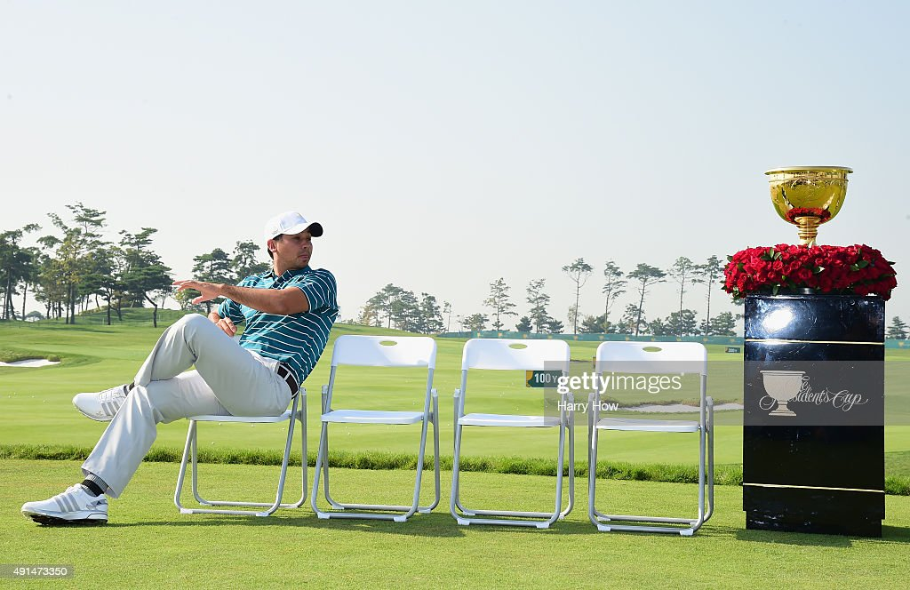 Jason Day of the International Team waits on the practice ground during a photocall prior to the start of The Presidents Cup at the Jack Nicklaus Golf Club on October 6, 2015 in Incheon City, South Korea.