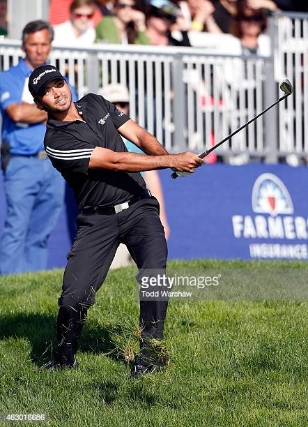 Jason Day plays a shot from the rough on the 18th hole during the final round of the Farmers Insurance Open at Torrey Pines South on February 8, 2015...