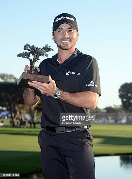 Jason Day poses with the championship trophy after his victory at the Farmers Insurance Open at Torrey Pines South on February 8, 2015 in La Jolla,...