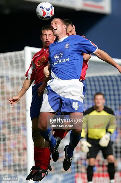 Jason De Vos of Ipswich jumps with Billy Jones of Crewe during the Coca-Cola Championship match between Ipswich Town and Crewe Alexandra at Portman...