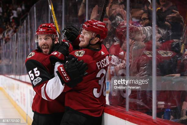 Jason Demers and Christian Fischer of the Arizona Coyotes celebrate after Fischer scored the game winning goal against the Los Angeles Kings in...