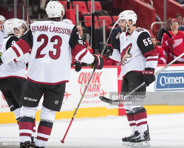 Jason Demers of the Arizona Coyotes celebrates his second period goal with teammates Oliver EkmanLarsson and Clayton Keller during an NHL game...