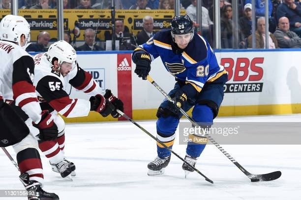 Jason Demers of the Arizona Coyotes defends against Alexander Steen of the St Louis Blues at Enterprise Center on March 12 2019 in St Louis Missouri