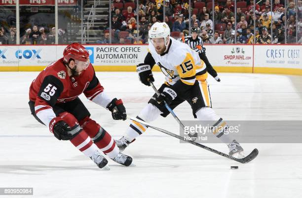 Jason Demers of the Arizona Coyotes skates in to gather the puck in front of Riley Sheahan of the Pittsburgh Penguins during the first period at Gila...