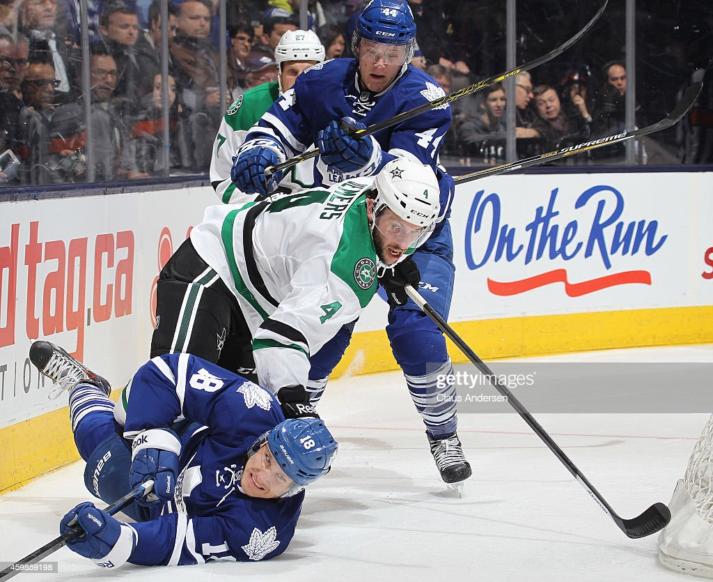 Jason Demers #4 of the Dallas Stars battles between Richard Panik #18 and Morgan Rielly #44 of the Toronto Maple Leafs during an NHL game at the Air Canada Centre on December 2, 2014 in Toronto, Ontario, Canada. The Leafs defeated the Stars 5-3.