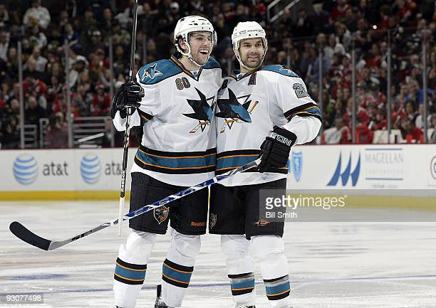 Jason Demers of the San Jose Sharks and teammate Dan Boyle celebrate after Demers scored against the Chicago Blackhawks on November 15 2009 at the...