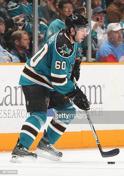 Jason Demers of the San Jose Sharks moves the puck during an NHL game against the Detroit Red Wings on January 9, 2010 at HP Pavilion at San Jose in...