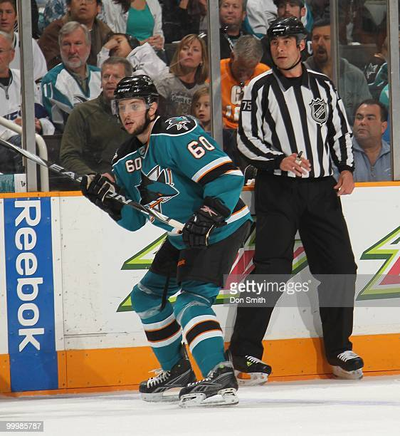Jason Demers of the San Jose Sharks watches the play with linesman Derek Amell in Game One of the Western Conference Finals during the 2010 NHL...
