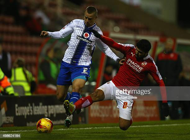 Jason Demetriou of Walsall is challenged by Yaser Kasim of Swindon Townduring the Sky Bet League One match between Swindon Town and Walsall at the...