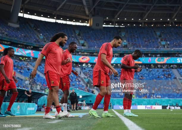 Jason Denayer, Christian Benteke, Nacer Chadli and Jeremy Doku of Belgium make their way towards the pitch to warm up prior to the UEFA Euro 2020...