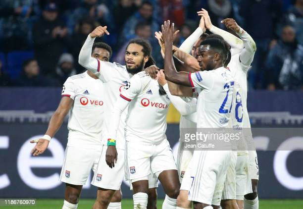 Jason Denayer, Maxwel Cornet of Lyon and teammates celebrate the goal of Bertrand Traore during the UEFA Champions League group G match between...