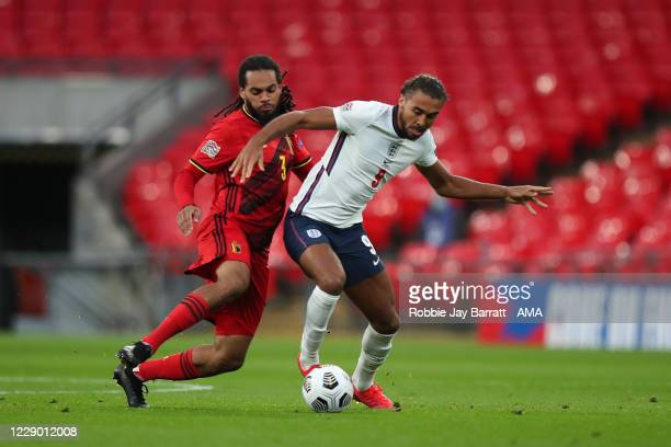 Jason Denayer of Belgium and Dominic Calvert-Lewin of England during the UEFA Nations League group stage match between England and Belgium at Wembley...