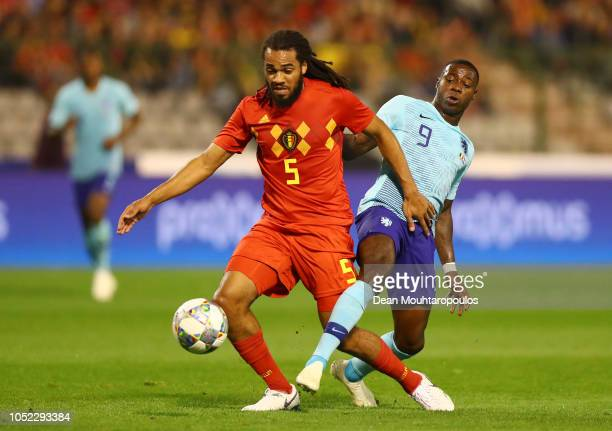 Jason Denayer of Belgium is challenged by Quincy Promes of the Netherlands during the International Friendly match between Belgium and Netherlands at...