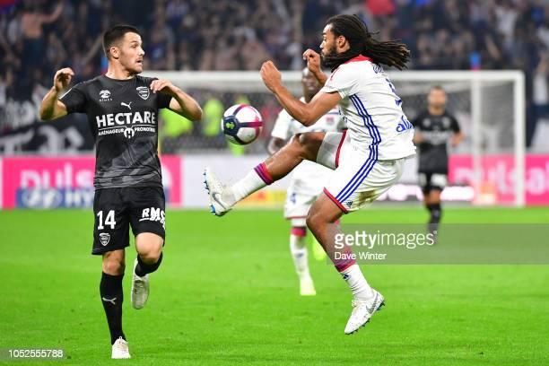 Jason Denayer of Lyon and Antonin Bobichon of Nimes during the Ligue 1 match between Lyon and Nimes at Groupama Stadium on October 19 2018 in Lyon...
