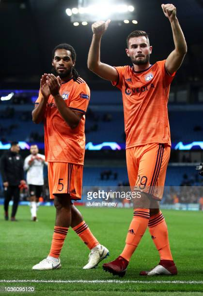 Jason Denayer of Lyon and Lucas Tousart of Lyon acknowledge the fans after the Group F match of the UEFA Champions League between Manchester City and...