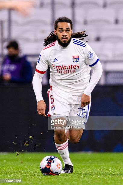 Jason Denayer of Olympique Lyon runs with the ball during the match between Olympique Lyonnais and Bordeaux at Groupama Stadium on January 29, 2021...