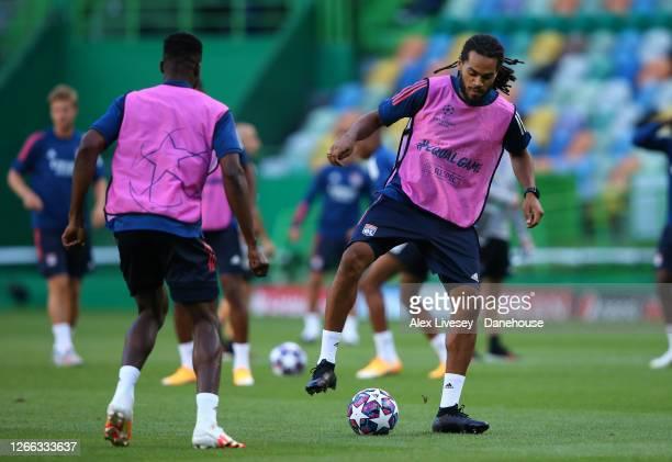 Jason Denayer of Olympique Lyonnais controls the ball during a training session ahead of their UEFA Champions League Quarter Final match against...
