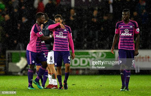 Jason Denayer of Sunderland and Papy Djilobodji of Sunderland are dejected after the final whistle during the Premier League match between Swansea...
